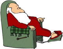 Santa Sleeping In A Chair Royalty Free Stock Photography