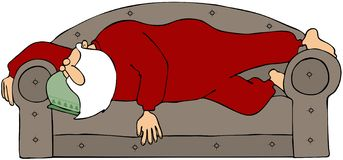 Santa Sleeping On A Couch Royalty Free Stock Images