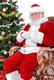 Santa sleeping in his char stock photography