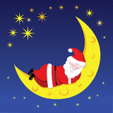 Santa sleeping on the moon Stock Photos