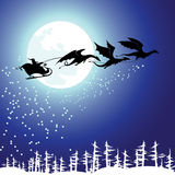 Santa on the sleigh. A dragon Stock Photo