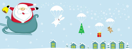 Santa  in sleigh. Cartoon Santa with bell in sleigh dropping presents with parachutes Royalty Free Stock Image
