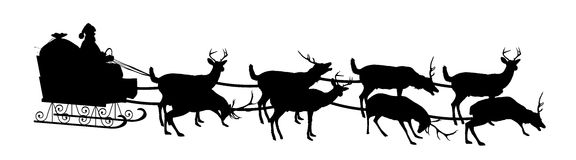 Santa and Sleigh. Silhouette of Santa in sleigh with reindeer Royalty Free Stock Photography