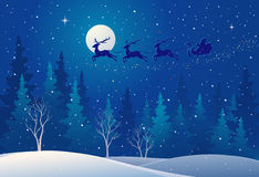Santa sleigh above forest Royalty Free Stock Images