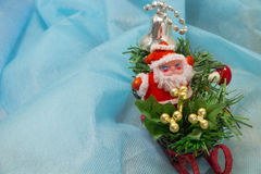 Santa in a sleigh on a blue background Stock Images