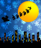 Santa Sleigh and Reindeers Flying Over the City Stock Image