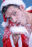 Santa snow blow Royalty Free Stock Photos