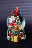 Santa Snow globe. A Christmas snow globe with Santa and elves delivering presents Stock Photography