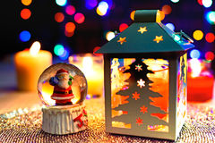 Santa Snow globe and Christmas pine lantern decoration Royalty Free Stock Photo