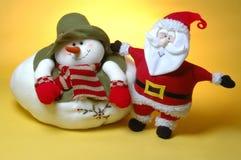 Santa and the snow man. Santa claus and the chubby snow man Royalty Free Stock Photography