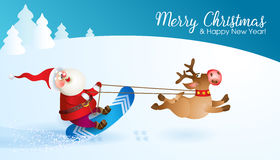 Santa snowboarding with Reindeer Royalty Free Stock Photography