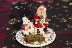Santa and Snowman Candle playing instruments on decorative table. Cloth royalty free stock images
