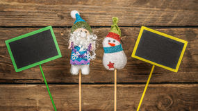 Santa and snowman with free black card. Stock Images
