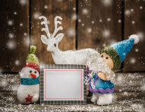 Santa snowman and reindeer with card. Royalty Free Stock Photography