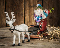Santa and snowman in a reindeer sleigh. Royalty Free Stock Photography