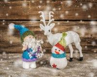 Santa snowman and reindeer. Stock Photo