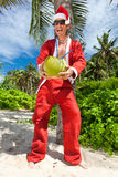 Santa sotto la palma tropicale Fotografie Stock Libere da Diritti