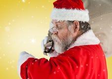 Santa sprawdza czas Fotografia Stock