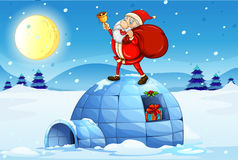 Santa standing above an igloo Royalty Free Stock Photography