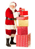 Santa: Standing By Large Stack of Gifts Stock Photography