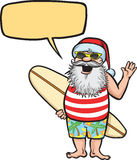 Santa standing with surfboard Royalty Free Stock Images