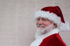 Santa Standing By A White Brick Wall Stock Images