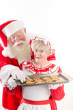 Santa steals a cookie Royalty Free Stock Images
