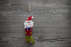 Santa stocking with giftbox attached to clothespin Stock Photo