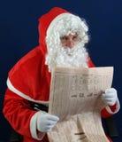 Santa studying Royalty Free Stock Photos