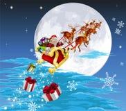 Santa in sua slitta Immagine Stock