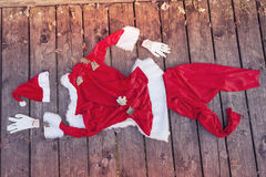 Santa suit abandoned on a wooden floor Stock Photography