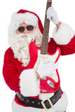 Santa with sunglasses playing electric guitar Stock Photography