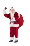 Santa suona la sua campana alla macchina fotografica Fotografia Stock Libera da Diritti