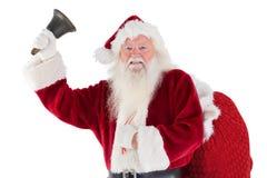 Santa suona la sua campana alla macchina fotografica Fotografia Stock