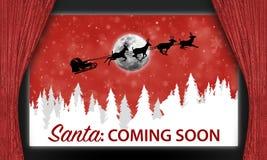 Santa sur l'écran de salle de cinéma Images stock