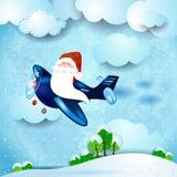 Santa sur l'avion, au-dessus de la campagne Photographie stock libre de droits