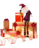 Santa sur les cadres de cadeau d'or et rouges Photographie stock libre de droits