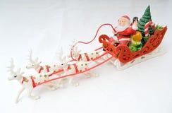 Santa sur son traîneau Images stock
