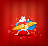 Santa with surfboard Royalty Free Stock Photo