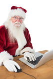Santa surfs on the internet Royalty Free Stock Images
