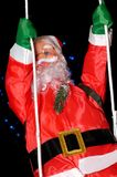 Santa on a Swing Royalty Free Stock Photography