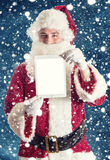 Santa with tablet stock photos