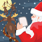 Santa with Tablet Royalty Free Stock Photo