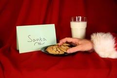 Santa takes a cookie Royalty Free Stock Photos