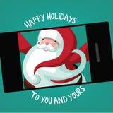 Santa takes a holiday selfie Stock Photo