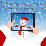 Santa takes photos of the snowman stock illustration