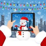 Santa takes photos of the snowman vector illustration
