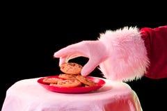 Santa taking cookie Stock Photography