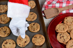 Santa Taking Fresh Baked Cookie Royalty Free Stock Photos