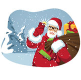 Santa taking a selfie with his bag of gifts Royalty Free Stock Photography
